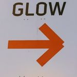 Glow sign with an arrow pointing to the right