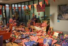 elderly people collecting gifts, for children, Vitalis, In Eindhoven.