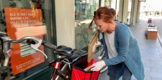 Booksellers delivering books on cycle to clients